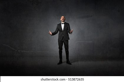 opera singer using voice, dark background