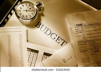 Operating budget, calendar and stopwatch