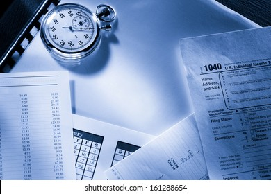 Operating budget, calendar, stopwatch and tax form