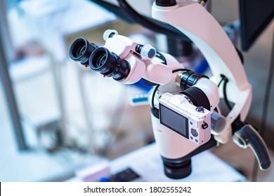 Operating microscope with built-in camera. Dental operating microscope. Dental optics. Dental equipment. Dentistry. Equipment for complex operations. - Shutterstock ID 1802555242
