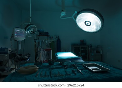 operating room with equipment in hospital , blue filter
