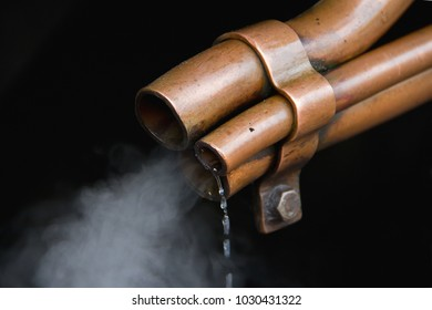 An operating vent on an old steam locomotive, removing water, to avoid damage to the pistons.