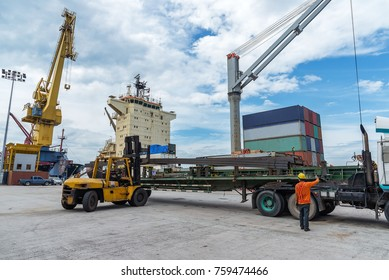 the operation of discharing loading carry on the port terminal by the ship vessel and the workers stevedore attenting through the time for transport and logistics system services