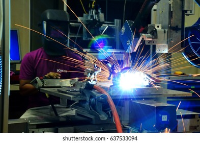 Operation of Laser welding machine, it is operated by a man to combine two or more material together.