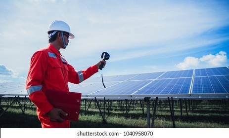 operation and maintenance in solar power plant ; engineering team working on checking and maintenance in solar power plant ,solar power plant to innovation of green energy for life