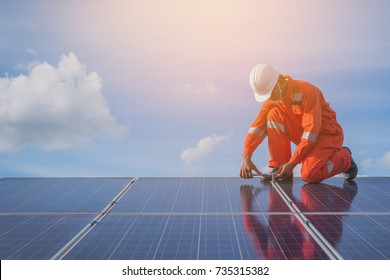 operation and maintenance in solar power plant ; engineer working on checking and maintenance in solar power plant ,solar power plant to innovation of green energy for life