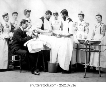 Operation on a female patient with the anesthetist applying ether, ca. 1880