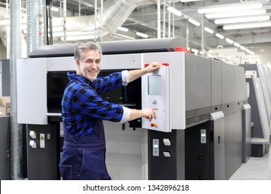 Operation of the printing machine. Printer in the printing house.