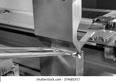 operator bending metal sheet by sheet bending machine