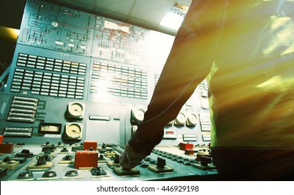 operator hand on the control panel power plant