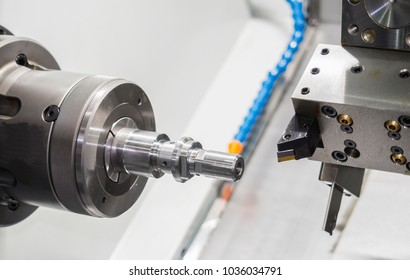Operator machining automotive part by cnc turning machine, Multi axis CNC turning and milling machine, High precision part manufacturing process with milling by endmill carbide