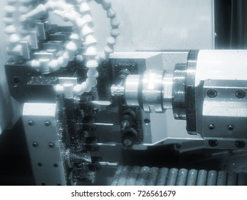 Operator machining automotive part by cnc turning machine