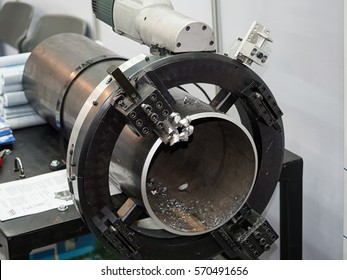 Operator machining steel pipe part by Pipe turning machine