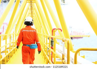 operator recording operation of oil and gas process at oil and rig plant, offshore oil and gas industry, offshore oil and rig in the sea, operator monitor production process, routine daily record.