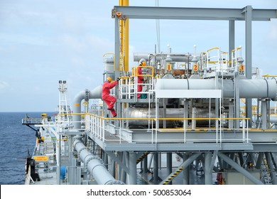 operator recording operation of oil and gas process at oil and rig plant, Pipe line on crude oil tanker in the gulf or the sea, The world energy, Offshore oil and rig construction.