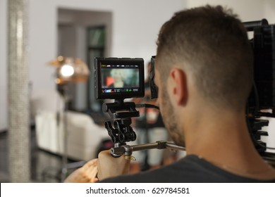 Operator while working with a large professional camera. Videographer shoots clip for famous star
