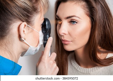 Ophthalmologist examines the eyes using a ophthalmic device. Ophthalmologist. medical, health, ophthalmology concept