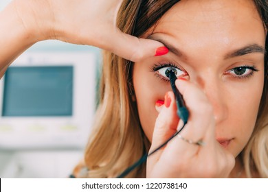 Ophthalmologist examining patient with ocular ultrasound (B-Scan)