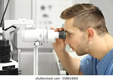 Ophthalmologist measuring intraocular pressure of patient in clinic