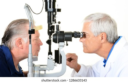 An Ophthalmologist and patient with a Slit Lamp to examine the interior of the eye.