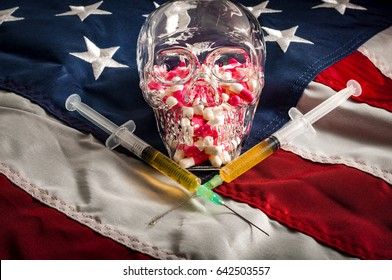 Opioid epidemic or opioid crisis and addiction to prescription drugs and heroin in America concept with a glass skull and two syringes on the US flag