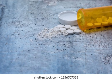 Opioid and prescription drug epidemic concept with pills and bottle and room for copy text