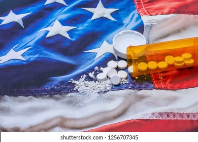 Opioid and prescription drug epidemic concept in United States with pills and bottle and room for copy text