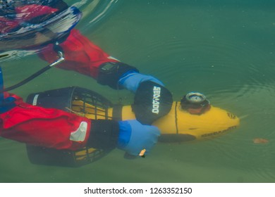 Opole, opolskie/Poland-07-01-2017 scuba diver underwater with a water scooter, the instructor shows underwater swimming with a water scooter, Diving is a good way to relax and move