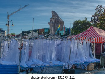 Opole, opolskie/Poland-09-21-2019: Franciscan fair, trade in materials and curtains on the occasion of St. Francis' Fair, trade on the main street, in the background a monument to local heroes
