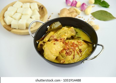 Opor ayam, chicken cooked in coconut milk from Central Java, Indonesia. Served with lontong (compressed rice cake). Popular dish for lebaran or Eid al-Fitr