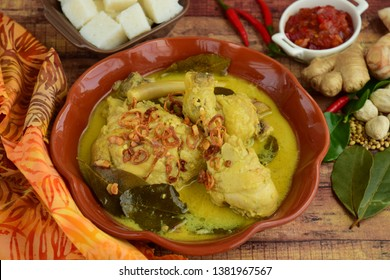 Opor ayam, chicken cooked in coconut milk from Indonesia, from Central Java, served with lontong and sambal. Popular dish for lebaran or Eid al-Fitr