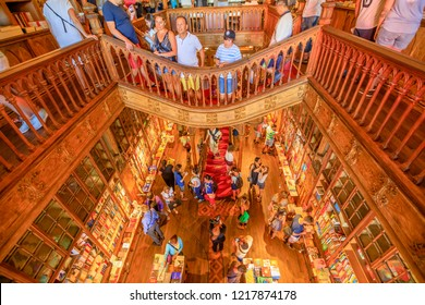 Oporto, Portugal - August 13, 2017: aerial view of people in Library Lello and Irmao, the major tourist attractions for Harry Potter fans. Rua das carmelitas in Porto historic center.