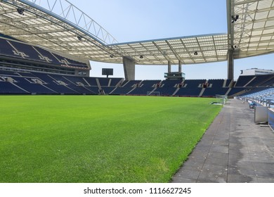 Oporto, Portugal - july 2016: Blue Seatings, Green Pitch, Gallery and Glass Benches inside Empty Stadium Before Soccer Match.