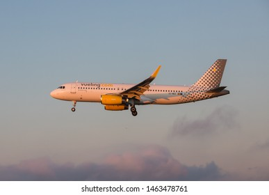 Oporto, Portugal - July 27, 2019: EC-MDZ Vueling Airlines Airbus A320-232 in the air over Oporto airport