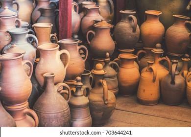 OPOSHNYA, UKRAINE - August 2017: Ukrainian pottery. Pottery market in Ukrainian village Oposhnya, center of Ukrainian pottery production. Different pottery products: bowls, vases, jars on the market.
