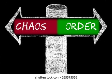 Opposite arrows with Chaos versus Order.Hand drawing with chalk on blackboard. Choice conceptual image