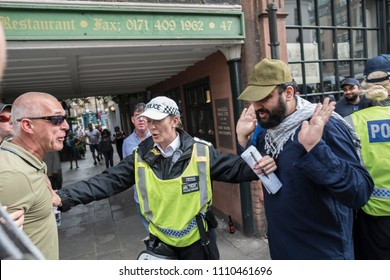An opposition protester clash with a Muslim during the Al Quds Day rally, London, 10/06/18.