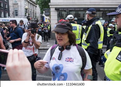 An opposition protester is interviewed by a youtube girl during the Al Quds Day rally, London, 10/06/18.