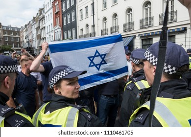 Opposition protesters hold an Israeli flag during the Al Quds Day rally, London, 10/06/18.