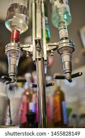 Optic drink dispensers on cocktail bar top