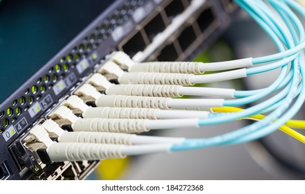 Optic fiber and SFP connected to switch.
