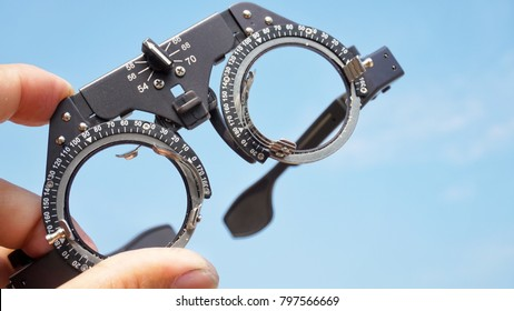Optical eyeglass frames are the equipment of the ophthalmologist and blue background image.