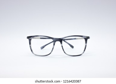 Optical eyeglasses. Glasses isolated on a white background. Modern style eyeglasses. Glasses with transparent lenses. Close up eyeglasses with blurry technique. Glasses front view.