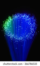 Optical fiber produce in the darkness a circle with points of light in the air.