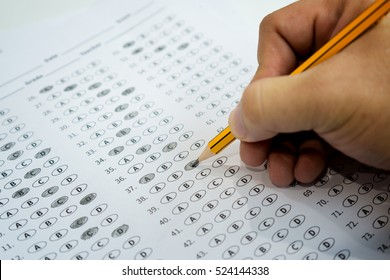 optical form of standardized test with answers bubbled and a black pencil examination,Answer sheet,education concept,selective focus,vintage