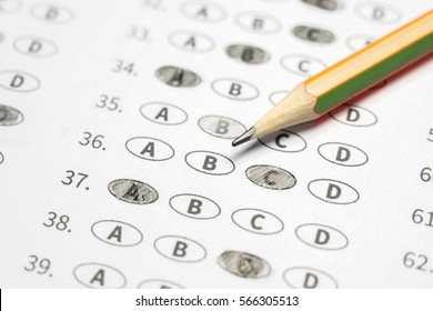 optical form of standardized test with answers bubbled and a black pencil examination,Answer sheet,education concept,selective focus,vintage color