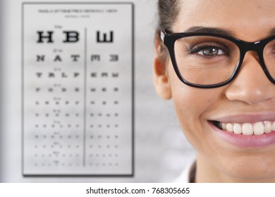 In an optical store, a boy makes a medical examination with the professional equipment to see how many dioptres are missing from sight. Concept of: medical examination, optic, eyes.