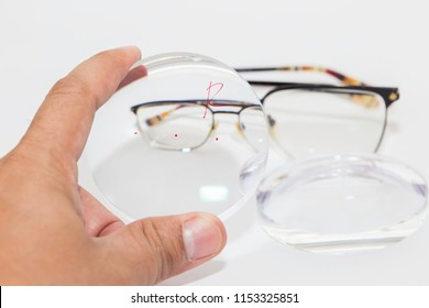 optician male check power lens Progressive Len,raw material on the digital device in optical store.