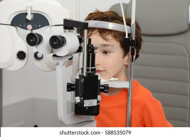 at the optician, optometrist in exam