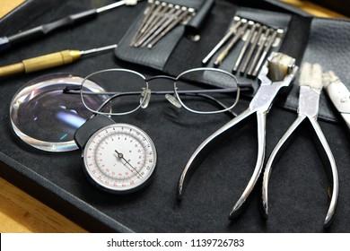 Optician repairing Equipment and fixing eyeglasses, Toolbox Repair Tool. Tooling Parts